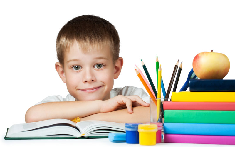 nice boy with books and pencils